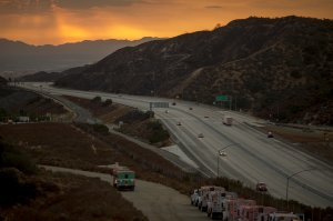 Traffic on the 210 freeway is allowed to resume for the first time since the start of the La Tuna Fire, as light rain showers pass over the burn areas on Sept. 3, 2017. (Credit: David McNew / Getty Images)