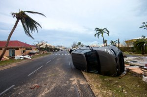A car turned onto its side in Marigot, near the Bay of Nettle, on the French Collectivity of Saint Martin, after the passage of Hurricane Irma on Sept.6, 2010. (Credit: LIONEL CHAMOISEAU/AFP/Getty Images)