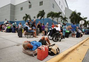 People wait in line to enter the Germain Arena in Estero, Florida, which is serving as a shelter from Hurricane Irma, on Sept. 9, 2017. (Credit: Mark Wilson/Getty Images)