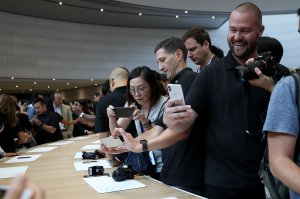 An attendee looks at a new iPhone X during an Apple special event at the Steve Jobs Theatre on the Apple campus on Sept. 12, 2017, in Cupertino. (Credit: Justin Sullivan/Getty Images)