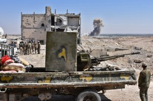 Syrian pro-government forces advance on the northern outskirts of Deir Ezzor on Sept. 14, 2017, during their ongoing battle against the Islamic State group. (Credit: George Ourfalian / AFP / Getty Images)