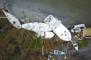 Damaged sail boats washed ashore are seen in the aftermath of Hurricane Maria in Fajardo, Puerto Rico, Sept. 21, 2017. (Credit: Ricardo Arduengo / AFP / Getty Images)