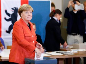 German Chancellor and CDU party leader Angela Merkel casts her vote at a polling station on Sept. 24, 2017, in Berlin. (Credit: ODD ANDERSEN/AFP/Getty Images)