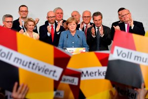 German Chancellor and Christian Democrats party leader Angela Merkel speaks on stage surrounded by her team during an election night event at the party headquarters in Berlin on Sept. 24, 2017. (Credit: TOBIAS SCHWARZ / AFP / Getty Images)