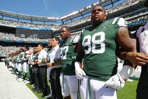 Mike Pennel of the New York Jets stands in unison with his teammates during the National Anthem prior to an NFL game against the Miami Dolphins at MetLife Stadium on Sept. 24, 2017. (Credit: Al Bello/Getty Images)