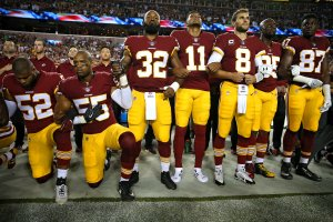 Washington Redskins players kneel and stand during the national anthem before the game against the Oakland Raiders in Landover, Md. on Sept. 24, 2017. (Credit: Patrick Smith/Getty Images)