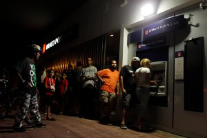 People make line at night at an ATM to withdraw money in San Juan, Puerto Rico, on Sept. 25, 2017. (Credit: Ricardo Arduengo / AFP / Getty Images)