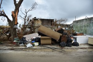 View of furniture near damaged houses in Punta Cabeza, Humacao, in the east of Puerto Rico, on September 27, 2017, one week after the passage of Hurricane Maria. (Credit: HECTOR RETAMAL/AFP/Getty Images)