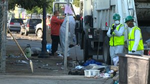 Contract workers in San Diego clean up city streets amid a worsening hepatitis A outbreak. (Credit: KSWB)