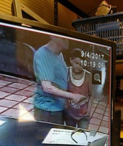 Joseph Hetzel, left, and Virginia Paris are seen checking out of an Arizona hotel in an image released Sept. 4, 2017, by the Santa Barbara County Sheriff's Office.