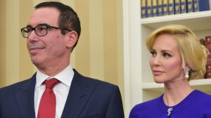 Steven Mnuchin and then-financee Louise Linton watch as President Trump speaks during Mnuchin's swearing-in ceremony on Feb. 13, 2017. (Credit: Mandel Ngan/AFP/Getty Images)