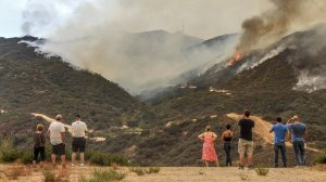 Residents watch the La Tuna fire raging in Verdugo Hills on Sept. 2, 2017. (Credit: Ifran Khan/Los Angeles Times)