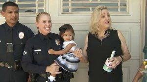 Officers Frank and Susan Garcia (left) are reunited with Marcy Schneidmiller (right) outside her home in Chino on Sept. 8, 2017 after the officers helped save her life last month. (Credit: KTLA)