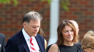 Fred and Cindy Warmbier are seen leaving Wyoming High School in Wyoming, Ohio on June 22, 2017, following the funeral for Otto Warmbier. (Credit: Paul Vernon /AFP/Getty Images)