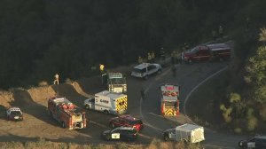 Emergency vehicles respond a car over the side of Glendora Mountain Road on Sept. 28, 2017. (Credit: KTLA)