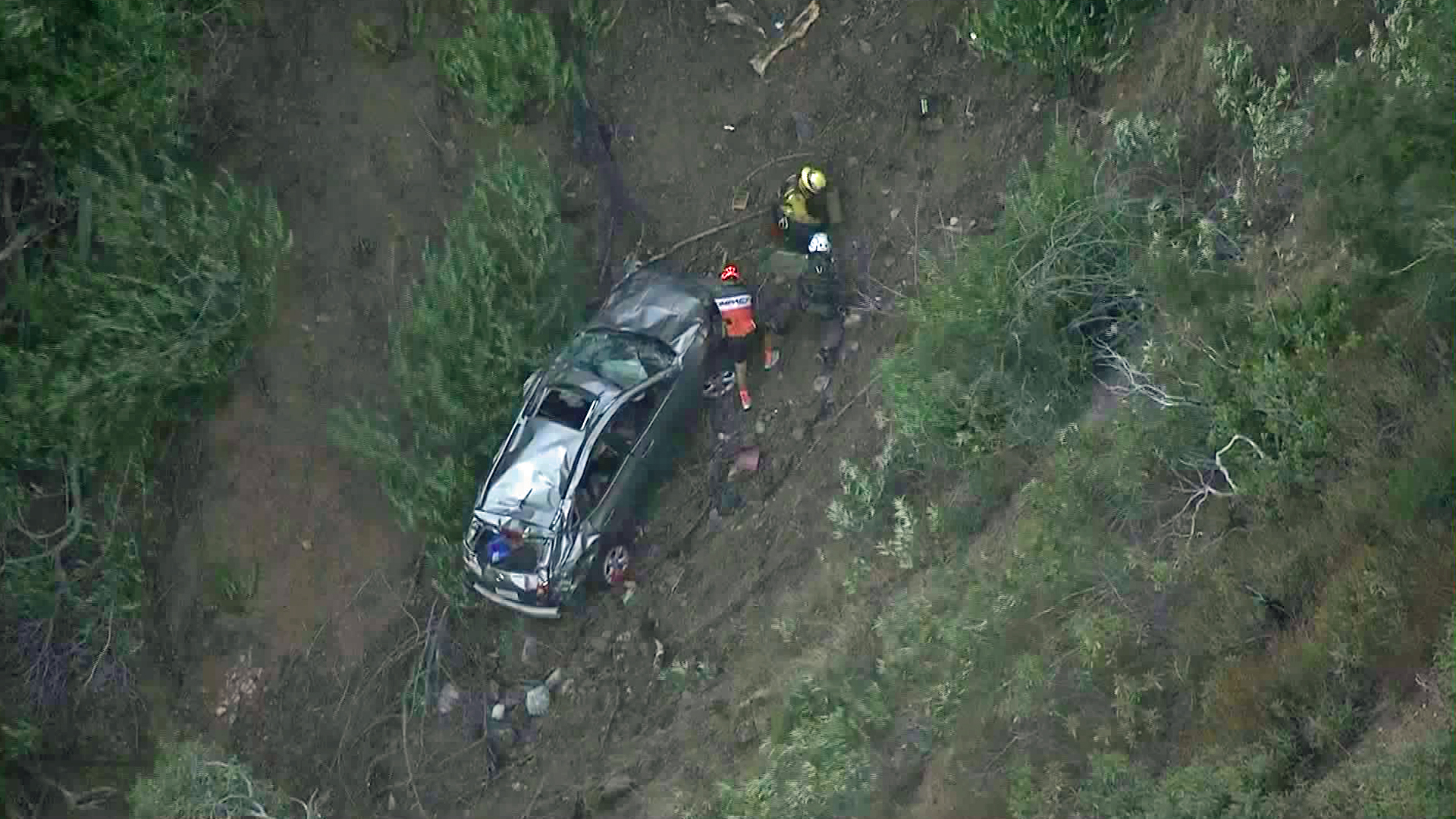 Rescuers respond to a car over the side of Glendora Mountain Road on Sept. 28, 2017. (Credit: KTLA)
