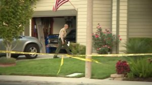 Officials investigate after a man was found dead in Santa Clarita on Sept. 24, 2017. (Credit: KTLA)