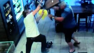A still from surveillance video shows a man thwarting a would be robber during an incident at a Fresno Starbucks in July, 2017.