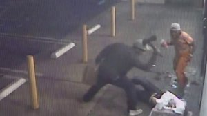 A man is seen striking another man with an ax in a still from surveillance footage captured at a 7-Eleven in West Hollywood and released by the Los Angeles County Sheriff's Department on Sept. 5, 2017.