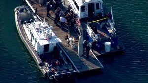 Police respond to the discovery of a barrel containing human remains in San Diego Bay on Oct. 12, 2017. (Credit: KSWB)