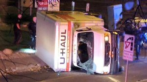 A rental truck lies on its side in Edmonton, Canada, on October 1, 2017, after a high speed chase.