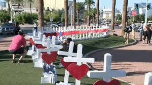 A tribute to the victims of a deadly mass shooting is seen on Las Vegas Boulevard. (Credit: KVVU via CNN)