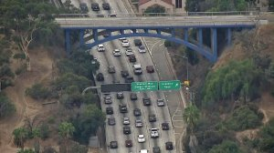 The Park Road bridge over the 110 Freeway near Dodger Stadium, shown Oct. 31, 2017, was painted blue in advance of Game 6 of the World Series. (Credit: KTLA)