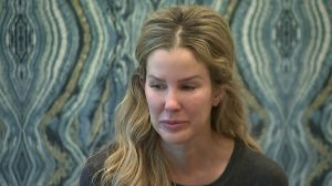 Karissa Fenwick gives a tearful account of the sexual advances she says Erick Guerrero, an associate professor at USC, made toward her. (Credit: KTLA)