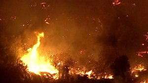 The Canyon Fire 2 in Orange County is seen burning through the area on Oct. 9, 2017. (Credit: KTLA)
