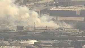 A structure fire is seen ay at a recycling facility in downtown Los Angeles. (Credit: KTLA)