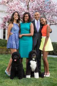 President Barack Obama, First Lady Michelle Obama, and daughters Malia (left) and Sasha (right) pose for a family portrait with their pets Bo and Sunny in the Rose Garden of the White House on Easter Sunday, April 5, 2015 (Credit: Pete Souza/The White House via Getty Images)