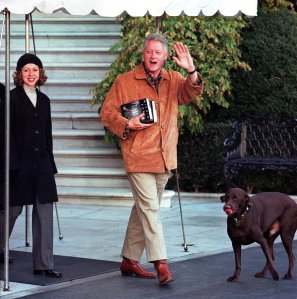 """President Bill Clinton, his daughter Chelsea and family dog """"Buddy"""" leaves the White House for a weekend retreat at Camp David on Nov. 20, 2000.(Credit: Manny Ceneta/AFP/Getty Images)"""