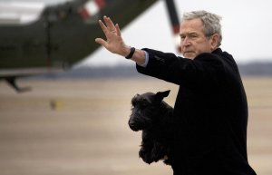 President George W. Bush carries his dog Barney off Air Force One upon landing at Texas State Technical College in Waco, Texas on December, 26, 2007. (Credit: Jim Watson/AFP/Getty Images)