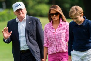 President Donald Trump, First Lady Melanie Trump and son Barron, walk from Marine One upon arrival on the South Lawn of the White House on Aug. 27, 2017, after spending the weekend at Camp David. (Credit: Saul Loeb/AFP/Getty Images)