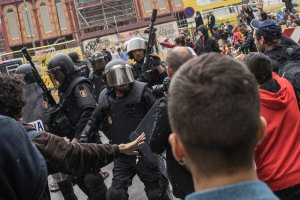 Pro-Referendum supporters clash with members of the Spanish National Police, after police tried to enter a polling station to retrieve ballot boxes during a referendum vote on October 1, 2017 in, Spain. (Credit: Dan Kitwood/Getty Images)