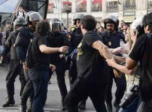 Some protesters confront Spanish National police officers during a demonstration at Puerta del Sol square in support of the right to hold a referendum on self-determination in Catalonia and against repression, in Madrid on October 1, 2017. (Credit: Javier Soriano/AFP/Getty Images)