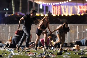 People run from the Route 91 Harvest country music festival after apparent gun fire was hear on October 1, 2017 in Las Vegas, Nevada. (Credit: David Becker/Getty Images)