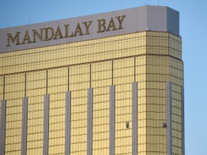 Broken windows are seen on the 32nd floor of the Mandalay Bay Resort and Casino after a lone gunman opened fired on the Route 91 Harvest country music festival on October 2, 2017 in Las Vegas, Nevada. (Credit: David Becker/Getty Images)