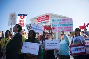 Demonstrators protest outside the U.S. Supreme Court in Washington, DC, Oct. 3, 2017, as the court hears arguments against gerrymandering.(Credit: Jim Watson / AFP / Getty Images)