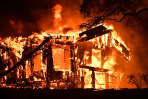 Flames ravage a home in the Napa wine region in California on Oct. 9, 2017, as multiple wind-driven fires continue to whip through the region. (Credit: Josh Edelson / AFP / Getty Images)