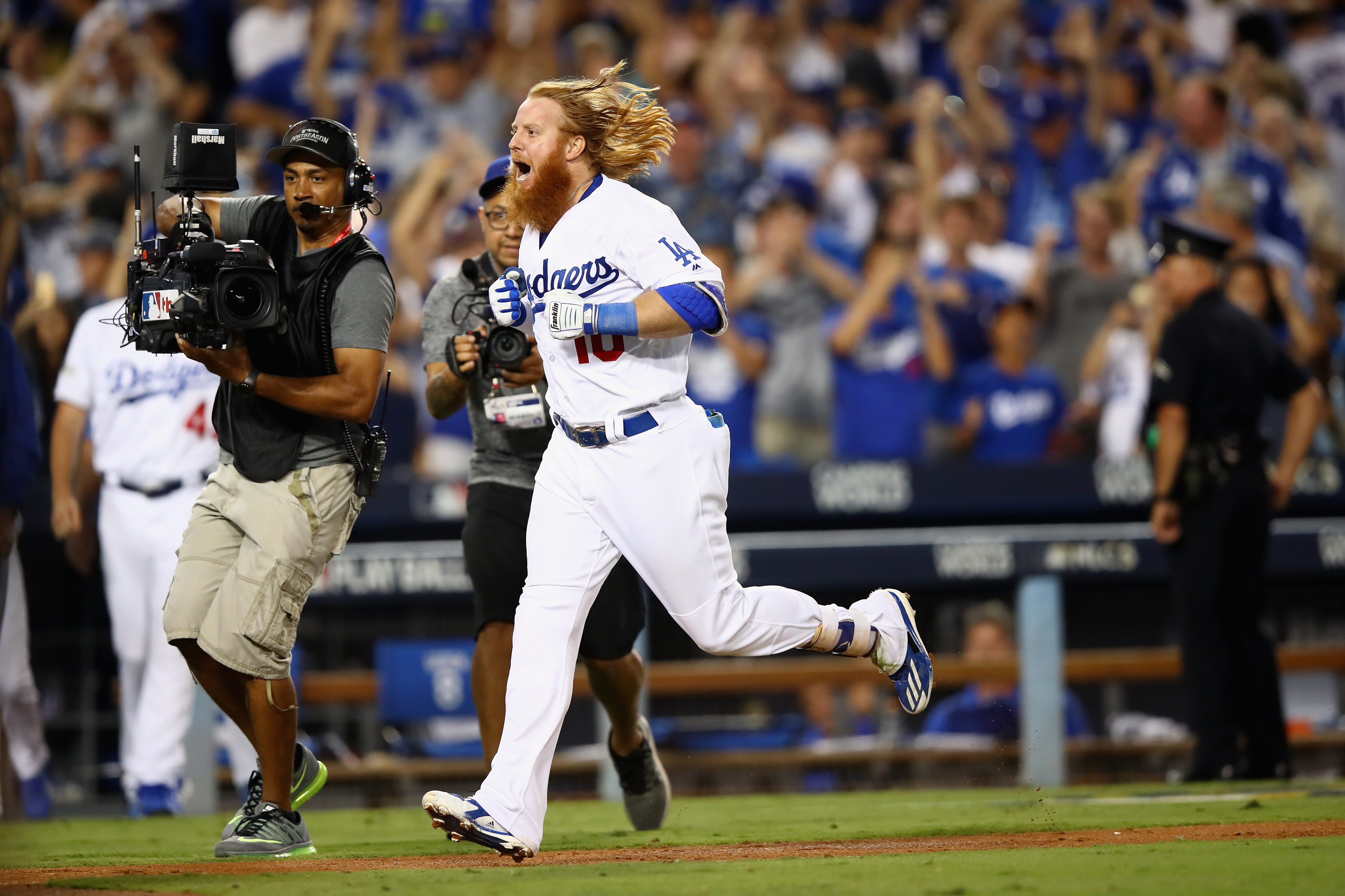 Justin Turner jobs home after hitting the winning home run in the bottom of the ninth during game two of the National League Championship Series against the Chicago Cubs at Dodger Stadium on October 15, 2017. (Credit: Ezra Shaw/Getty Images)