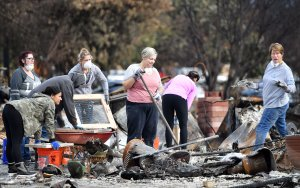 Residents search for an engagement ring at a burned residence in Santa Rosa, California on October 20, 2017. Residents are being allowed to return to their burned homes on October 20 to grieve and search through remains. (Credit: Josh Edelson/AFP/Getty Images)