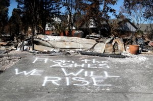 A message is written on driveway of a Coffey Park home that was destroyed by the Tubbs Fire on Oct. 23, 2017, in Santa Rosa. (Credit: Justin Sullivan / Getty Images)
