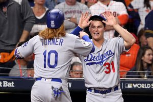 Dodgers player Justin Turner celebrates scoring an RBI single during the first inning with teammate Joc Pederson in Game 5 of the 2017 World Series against the Houston Astros at Minute Maid Park on Oct. 29, 2017, in Houston, Texas. (Credit: Christian Petersen/Getty Images)