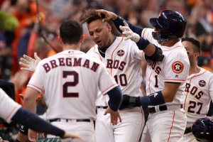 Houston Astros player Yuli Gurriel celebrates after hitting a three-run home run during the fourth inning against the L.A. Dodgers in Game 5 of the 2017 World Series at Minute Maid Park on Oct. 29, 2017 in Houston, Texas. (Credit: Christian Petersen/Getty Images)