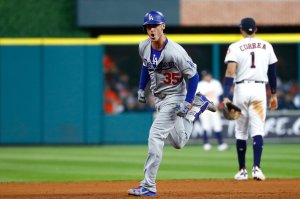 Dodgers player Cody Bellinger rounds the bases after hitting a three-run homer during the fifth inning against the Houston Astros in Game 5 of the 2017 World Series at Minute Maid Park on Oct. 29, 2017, in Houston, Texas. (Credit: Jamie Squire/Getty Images)