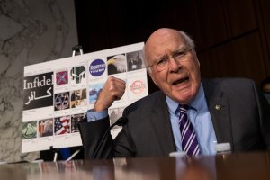 With examples of Russian-created Facebook pages behind him, Sen. Patrick Leahy questions witnesses during a Senate hearing on Russian disinformation online on Oct. 31, 2017. (Credit: Drew Angerer/Getty Images)