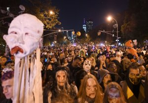 People dressed in costumes take part in the 44rd Annual Halloween Parade in New York City on Oct. 31, 2017. (Credit: Angela Weiss/AFP/Getty Images)