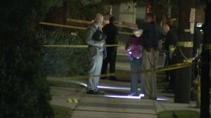 Detectives investigate the scene of a shooting that left a 16-year-old boy dead in Harbor City on Oct. 17, 2017. (Credit: KTLA)