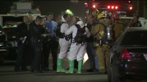 A hazmat crew responds after a woman and two children were found covered in white powder in South L.A. on Oct. 19, 2017. (Credit: KTLA)
